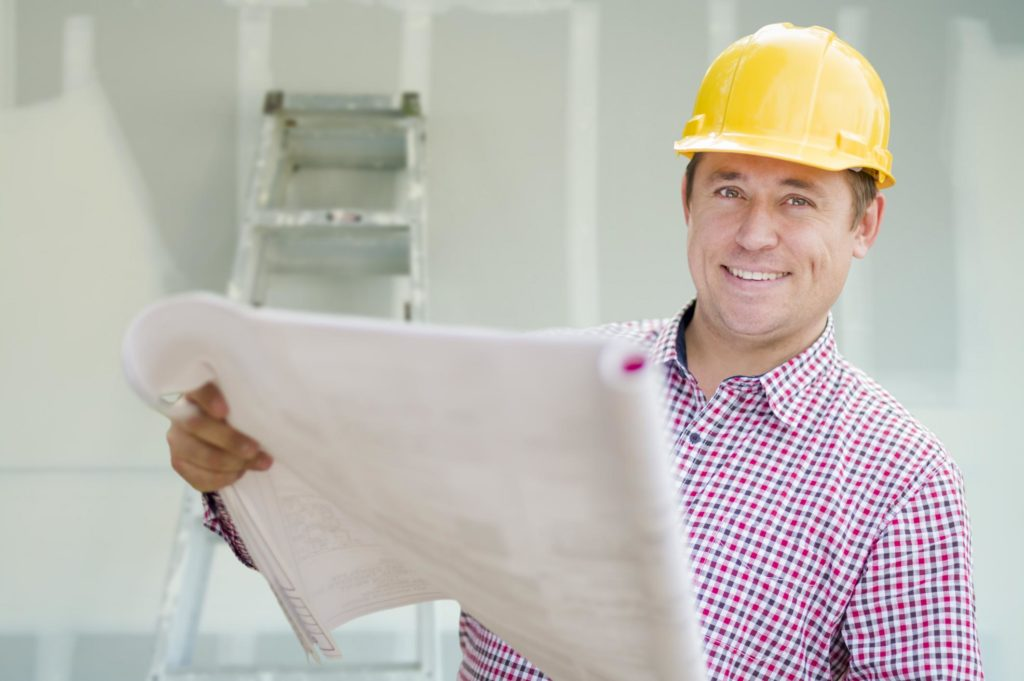man is holding construction plan